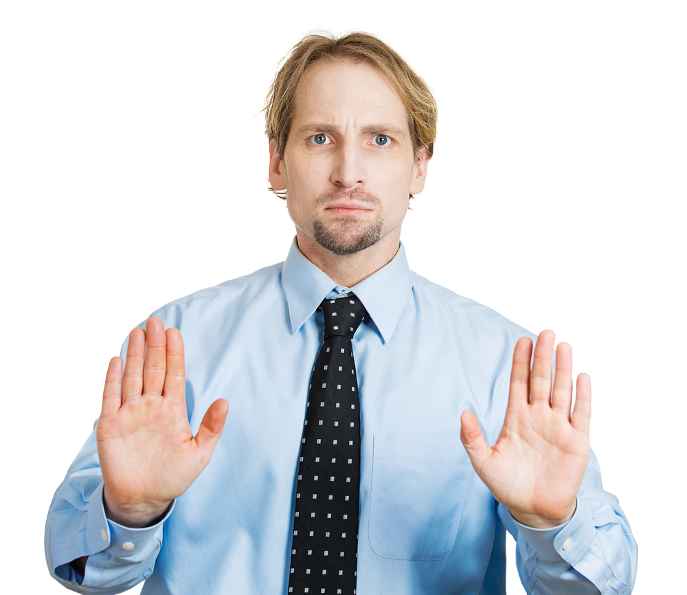 Closeup portrait, angry pissed off young man raising hand up to say no stop right there, isolated white background. Negative emotion facial expression feelings, signs symbols, body language